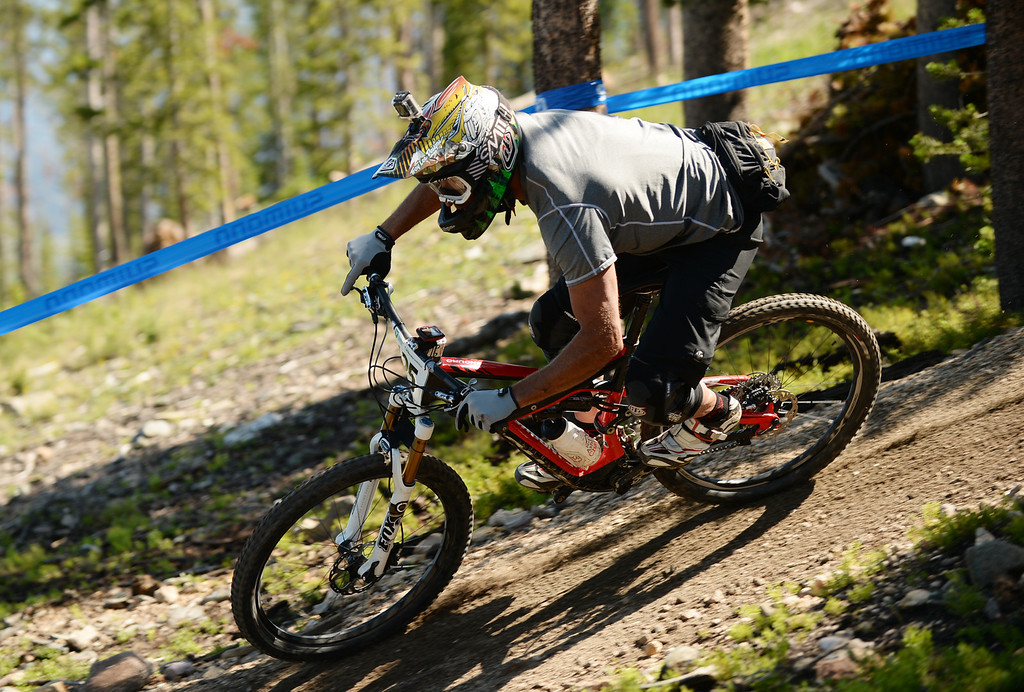 . WINTER PARK, CO. - July 26: Craig Harvey controls the bike during the first stage of First international Enduro World Cup Championship ever in U.S. at Winter Park, Colorado. July 26, 2013.  (Photo By Hyoung Chang/The Denver Post)