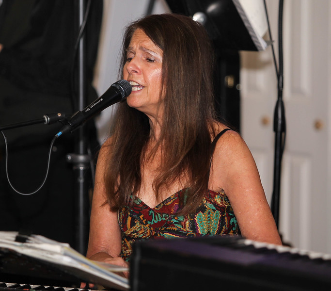 February 23, 2019: Strangers band pianist Julie Parsons sings during the Winter Dinner/Dance Christmas in April event in Clinton. Photo by: Chris Thompkins/Prince George's Sentinel