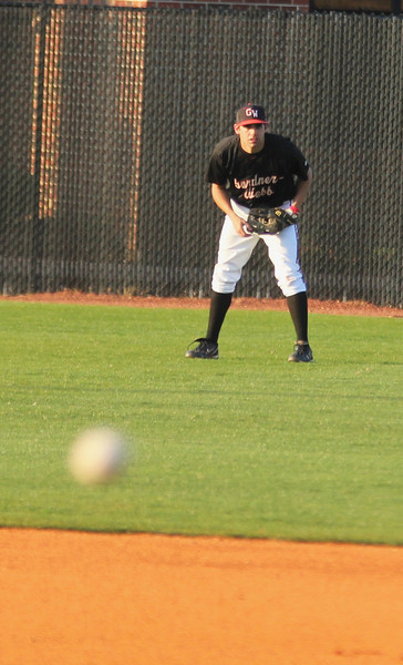 #21 Adam McFarland awaits a pitch in the outfield on Friday, March 18th, 2011.