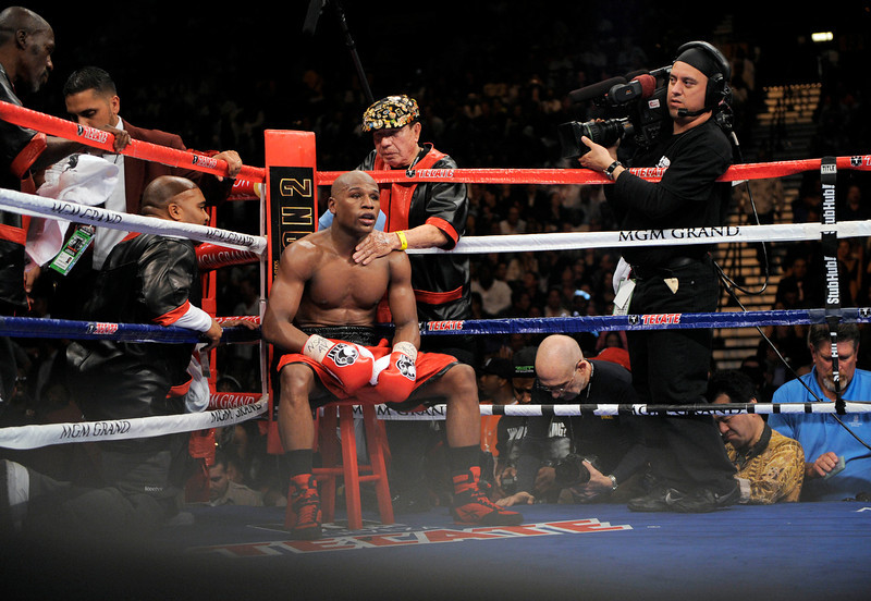. Floyd Mayweather Jr. is seen in his corner between rounds against Shane Mosley during their WBA welterweight boxing match Saturday, May 1, 2010, in Las Vegas. Mayweather Jr. beat Shane Mosley in a unanimous decision. (AP Photo/Mark J. Terrill)