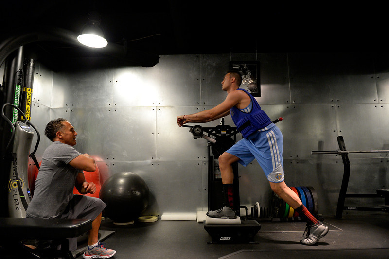 . Denver Nuggets Danilo Gallinari is carefully watched by assistant coach/strength and conditioning Steve Hess May 27, 2014 at Pepsi Center. (Photo by John Leyba/The Denver Post)