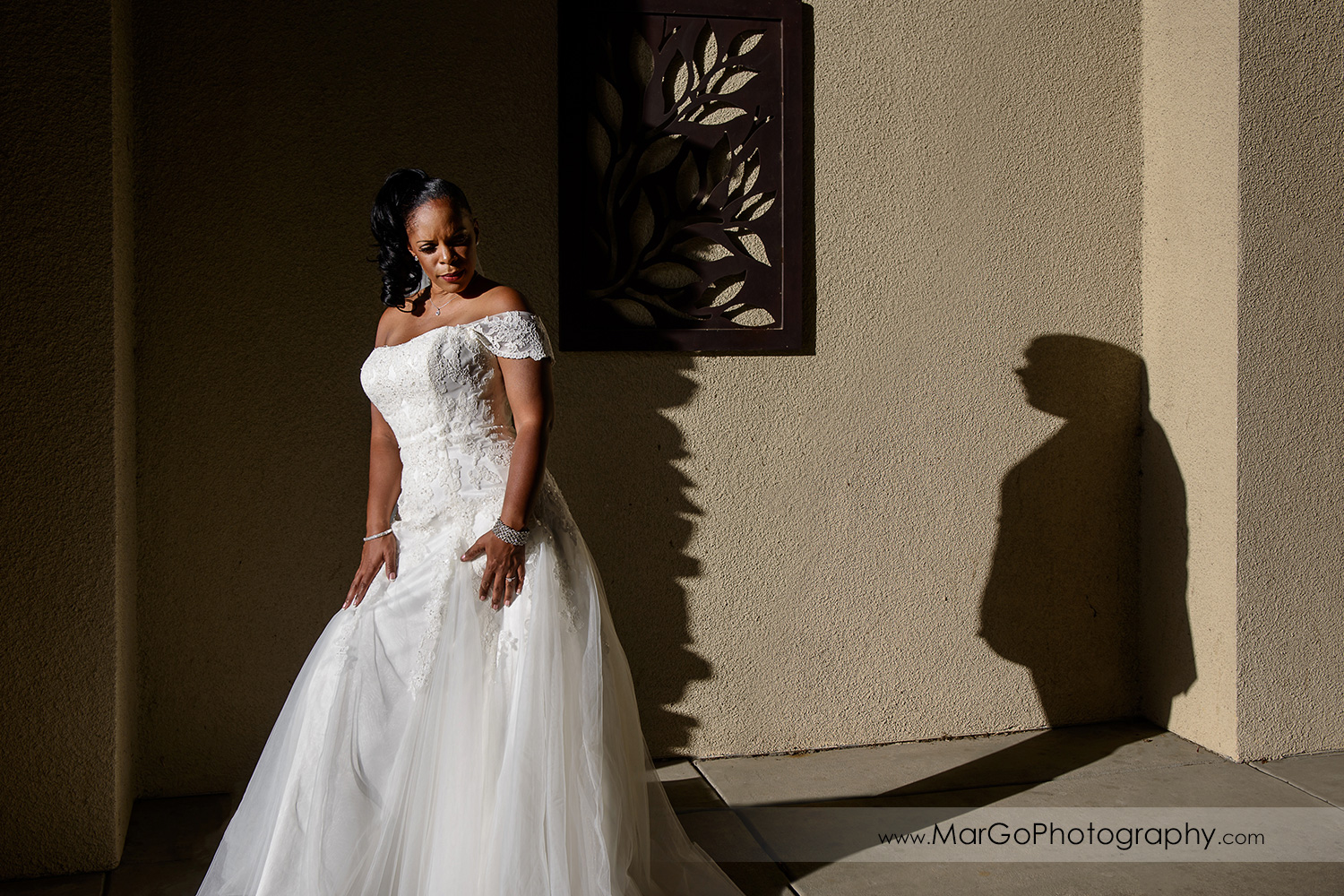 bridge with groom's shadow at Wedgewood Wedding & Banquet Center in Brentwood