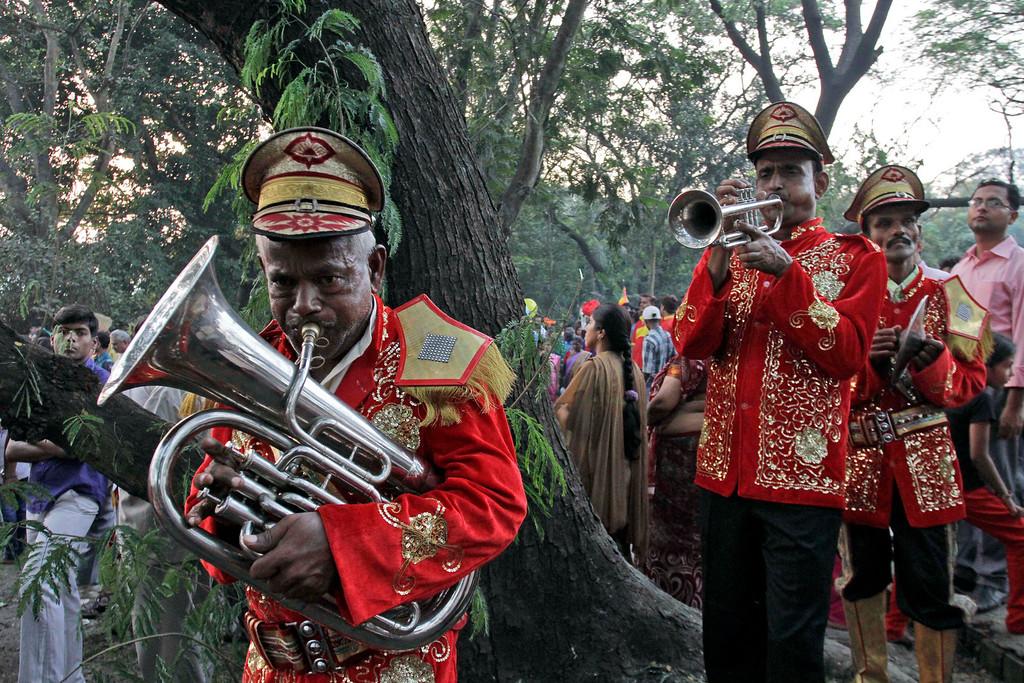 . Members of a brass band perform during a procession to mark Chhath Puja festival at a lake in Kolkata, India, Friday, Nov. 8, 2013.  (AP Photo/Bikas Das)
