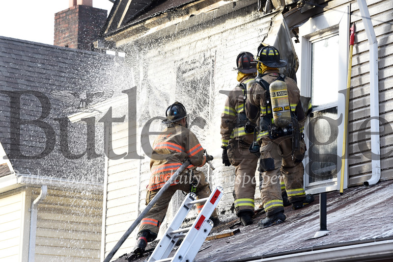 Harold Aughton/Butler Eagle: Butler firefighters battle a blaze that broke out at 223 W. North Street in Butler Thursday, December 26, 2019.