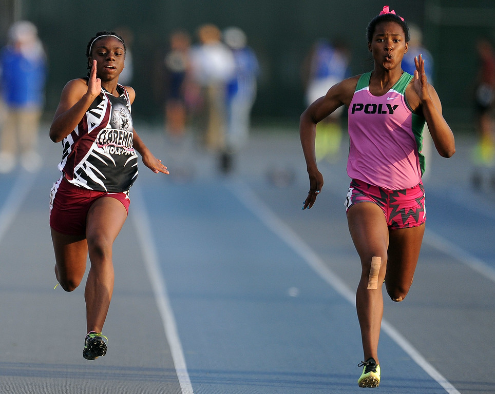 . Long Beach Poly\'s Arianna Washington wins the 100 meter dash ahead of Claremont\'s BrittanyBrown, left, during the CIF-SS Masters Meet at Cerritos College on Friday, May 24, 2013 in Norwalk, Calif.  (Keith Birmingham Pasadena Star-News)