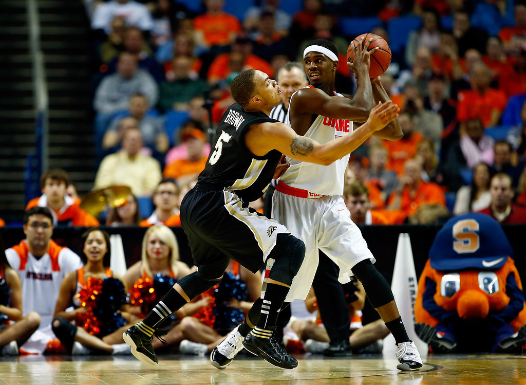 . BUFFALO, NY - MARCH 20: David Brown #5 of the Western Michigan Broncos defends against C.J. Fair #5 of the Syracuse Orange during the second round of the 2014 NCAA Men\'s Basketball Tournament at the First Niagara Center on March 20, 2014 in Buffalo, New York.  (Photo by Jared Wickerham/Getty Images)