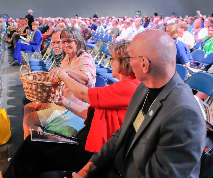 A basket gets passed during the Miracle Offering at the Friday Plenary at the 2017 INUMC Annual Conference in Indianapolis.
