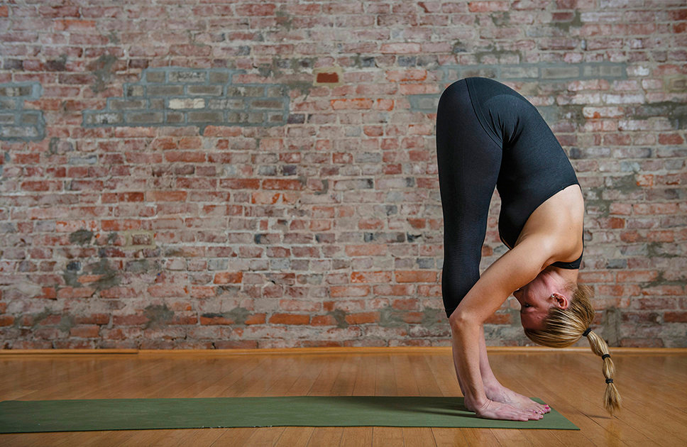 . Yoga instructor Mimi Rieger demonstrates a sun salutation sequence. Left to right:  3)  Exhale and fold forward over your legs.  (Photo for The Washington Post by Amanda Voisard.)