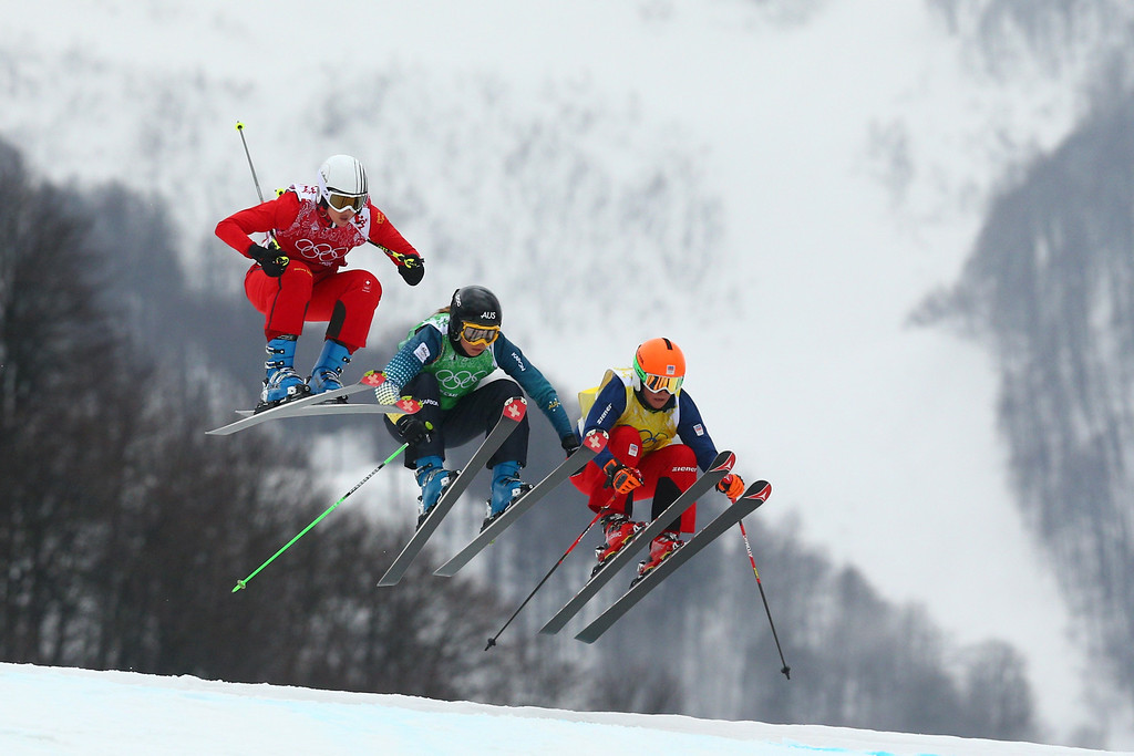 . (L-R)  Sanna Luedi of Switzerland, Katya Crema of Australia, Nikol Kucerova of Czech Republic compete in the Freestyle Skiing Womens\' Ski Cross 1/8 Finals on day 14 of the 2014 Winter Olympics at Rosa Khutor Extreme Park on February 21, 2014 in Sochi, Russia.  (Photo by Cameron Spencer/Getty Images)