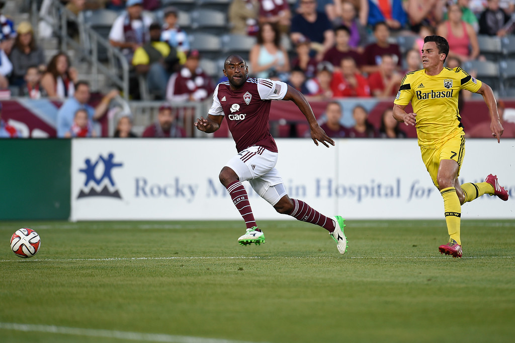 . Marvell Wynne #22 of the Colorado Rapids looks to pass the ball while trailed by Bernardo Anor #7 of the Columbus Crew during the first half of an MLS game at Dick\'s Sporting Goods Park on July 4, 2014, in Commerce City, Colorado.  The Rapids and Crew drew 1-1. (Photo by Daniel Petty/The Denver Post)