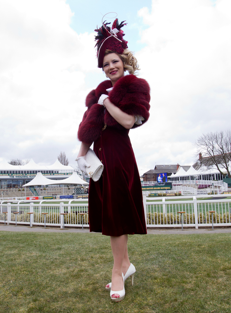 . Milliner Mimi Theobald from Inverness wears one of her creations during Ladies\' Day at Aintree Racecourse Liverpool, England, Friday, April 5, 2013. (AP Photo/Jon Super)