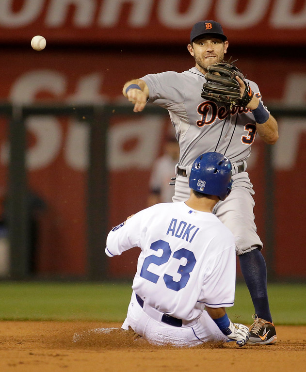 . Detroit Tigers second baseman Ian Kinsler (3) throws to first for the double play hit into by Kansas City Royals\' Lorenzo Cain after forcing Norichika Aoki out at second during the first inning of a baseball game Friday, Sept. 19, 2014, in Kansas City, Mo. (AP Photo/Charlie Riedel)