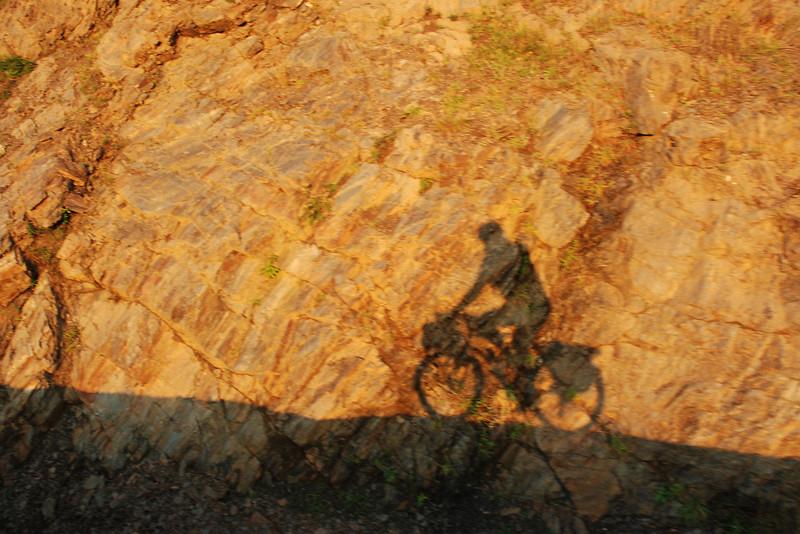 Silhouette de cycliste sur la Cabot Trail - Parc national des Hautes-Terres du Cap Breton
