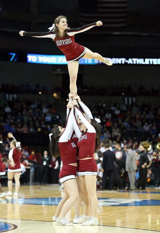. The Harvard Crimson cheerleaders cheer on their team during their game against the Cincinnati Bearcats in the second round of the 2014 NCAA Men\'s Basketball Tournament at Spokane Veterans Memorial Arena on March 20, 2014 in Spokane, Washington.  (Photo by Stephen Dunn/Getty Images)