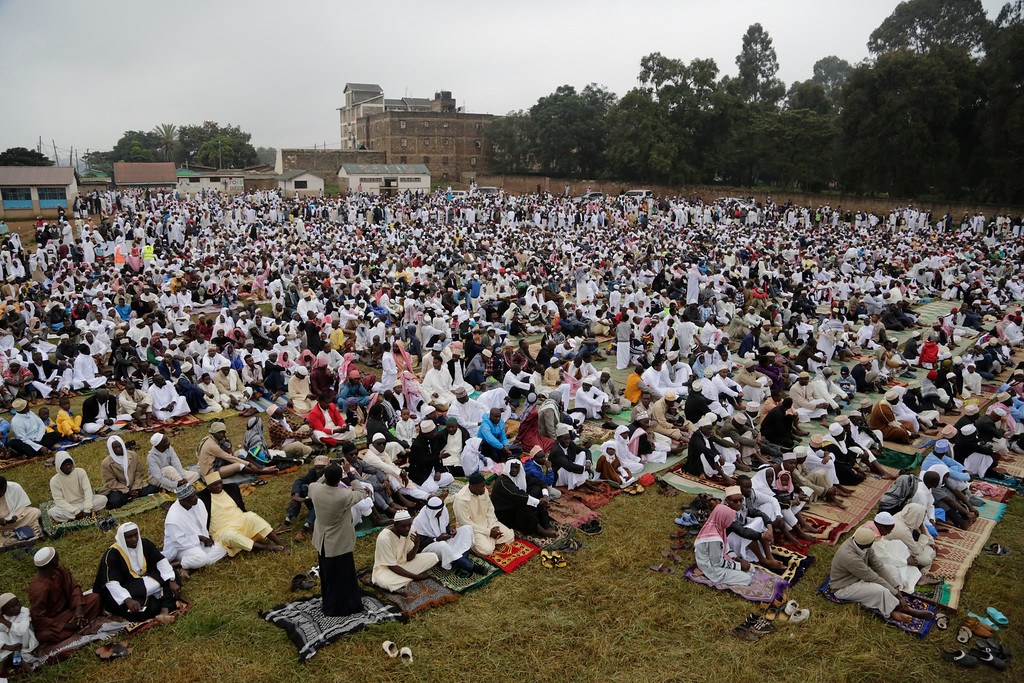 . Kenyan Muslims pray during the Eid al-Fitr prayers in Kibera Nairobi, Kenya, Friday, June 15, 2018. Muslims around the world celebrate the end of the holy month of Ramadan. (AP Photo/Khalil Senosi)