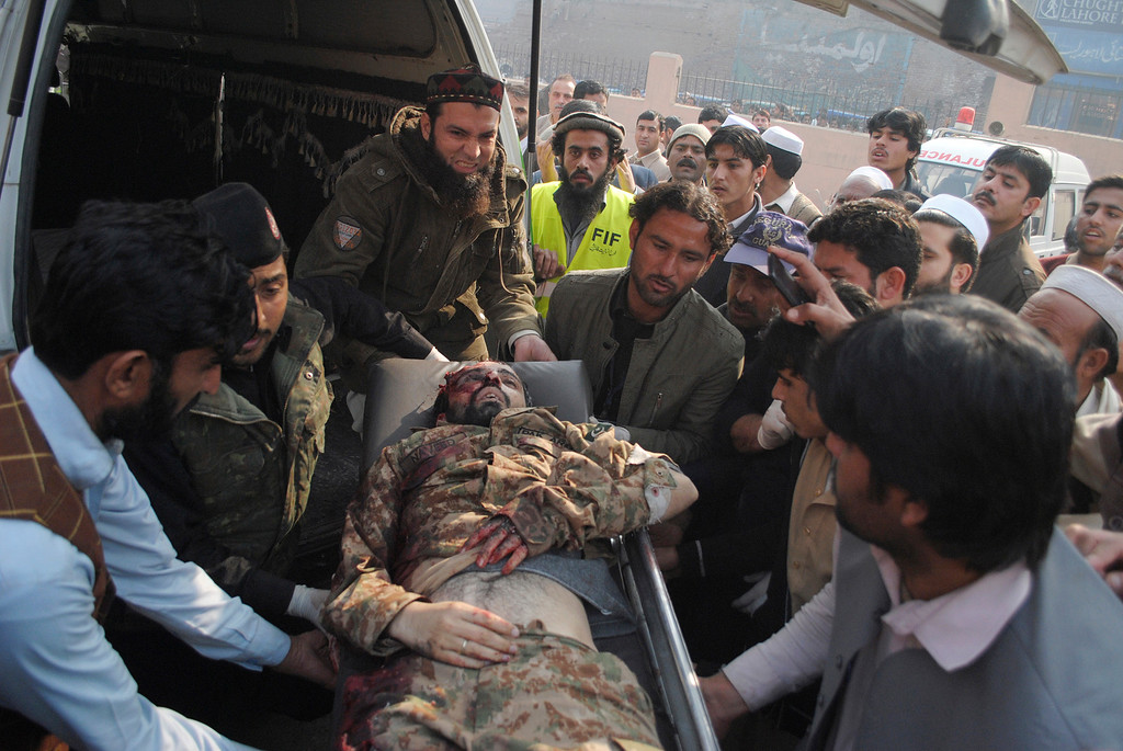 . The lifeless body of a Pakistani army officer, a victim of a Taliban attack in a school, is brought to a local hospital in Peshawar, Pakistan, Tuesday, Dec. 16, 2014. Taliban gunmen stormed a military-run school in the northwestern Pakistani city of Peshawar on Tuesday, killing and wounding scores, officials said, in the highest-profile militant attack to hit the troubled region in months.(AP Photo/Mohammad Sajjad)