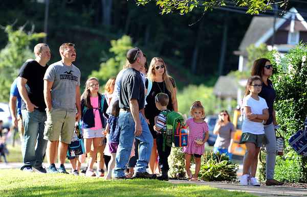 8/29/2019 Mike Orazzi | Staff Parents and students arrive at the Derynoski Elementary School on Southington's first day back this year.