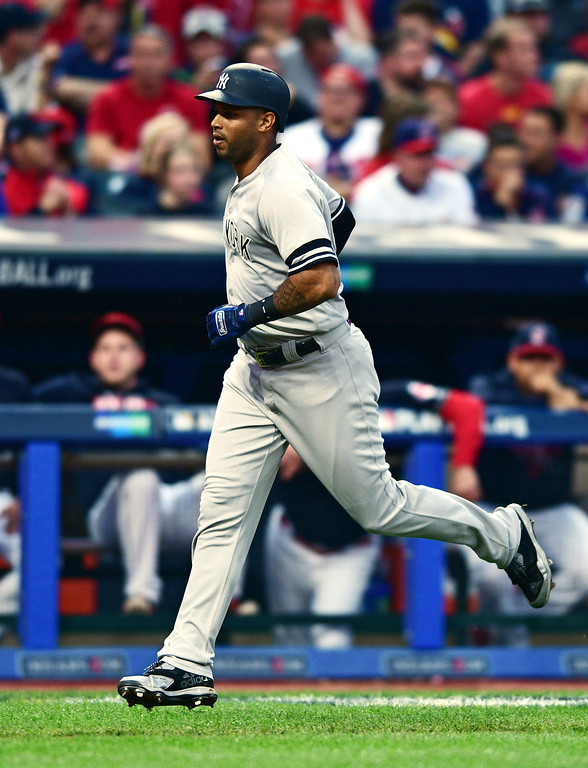 . New York Yankees\' Aaron Hicks runs the bases after hitting a three-run home run in the third inning of Game 2 of baseball\'s American League Division Series against the Cleveland Indians, Friday, Oct. 6, 2017, in Cleveland. Starlin Castro and Greg Bird scored on the play. (AP Photo/David Dermer)