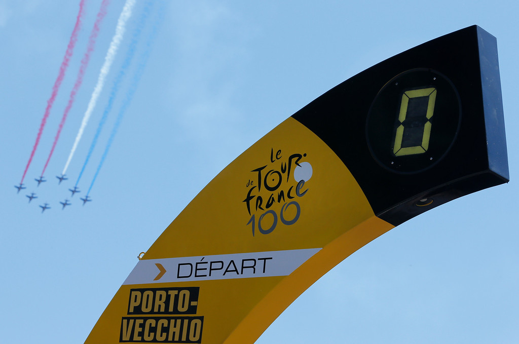. The Patrouille de France aerobatic team performs at the start of the first stage of the 100th edition of the Tour de France cycling race over 213 kilometers (133 miles) with start in Porto Vecchio and finish in Bastia, Corsica island, France, Saturday June 29, 2013. (AP Photo/Laurent Cipriani)
