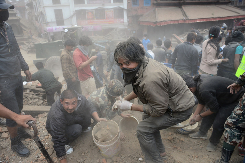 . People clear rubble in Kathmandu\'s Durbar Square, a UNESCO World Heritage Site that was severely damaged by an earthquake on April 25, 2015. A massive 7.8 magnitude earthquake killed hundreds of people April 25 as it ripped through large parts of Nepal, toppling office blocks and towers in Kathmandu and triggering a deadly avalanche that hit Everest base camp. PRAKASH MATHEMA/AFP/Getty Images