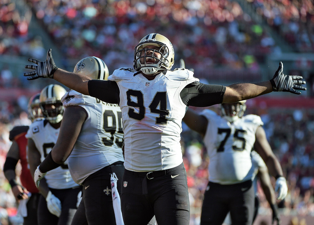 . New Orleans Saints defensive end Cameron Jordan (94) celebrates after stopping the Tampa Bay Buccaneers on a run during the fourth quarter of an NFL football game Sunday, Dec. 28, 2014, in Tampa, Fla. (AP Photo/Phelan M. Ebenhack)