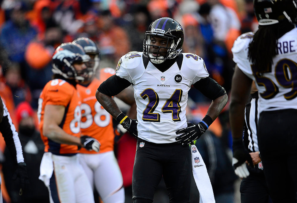 Description of . Baltimore Ravens cornerback Corey Graham (24) catches his breath after a play in the second quarter. The Denver Broncos vs Baltimore Ravens AFC Divisional playoff game at Sports Authority Field Saturday January 12, 2013. (Photo by AAron  Ontiveroz,/The Denver Post)