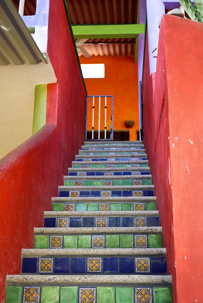 Pretty steps and a colorful adobe house in San Pancho, Mexico.