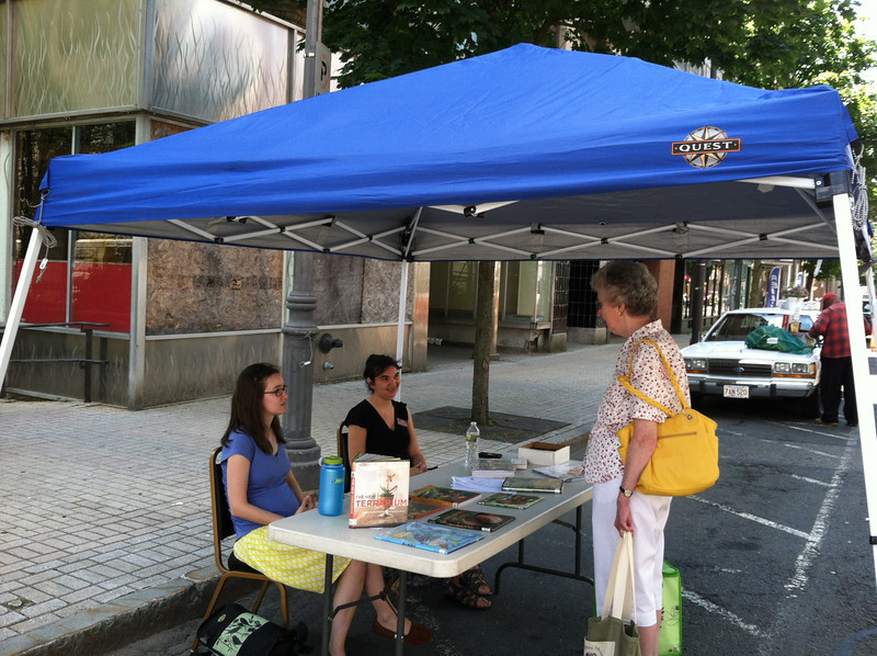 Another day of library outreach at the Farmers' Market. June 28, 2012. This blue tent had been used by my former library project (health information at the Farmer's Market summer 2006); I donated it to provide shade for current library staff.