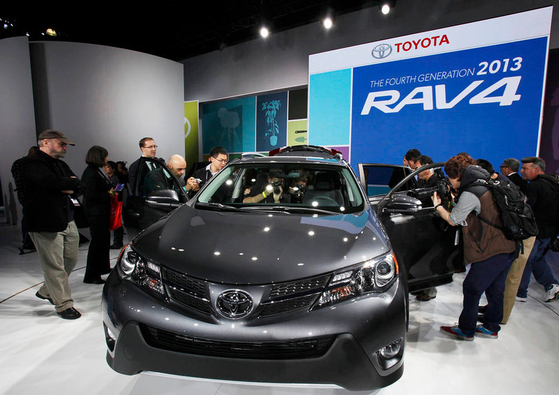 . Attendees photograph the 2012 Toyota RAV4 at the 2012 Los Angeles Auto Show in Los Angeles, California November 28, 2012.   REUTERS/Mario Anzuoni