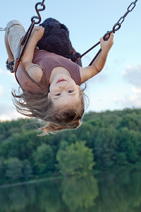 """She loves to """"fly"""" when she swings, which means we get our exercise pushing her as hard as we can."""