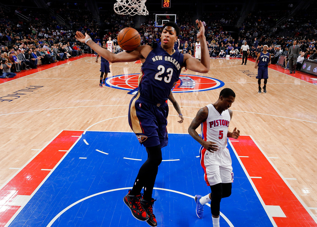 . New Orleans Pelicans forward Anthony Davis (23) dunks against the Detroit Pistons during the first half of an NBA basketball game in Auburn Hills, Mich., Wednesday, Jan. 14, 2015. (AP Photo/Paul Sancya)
