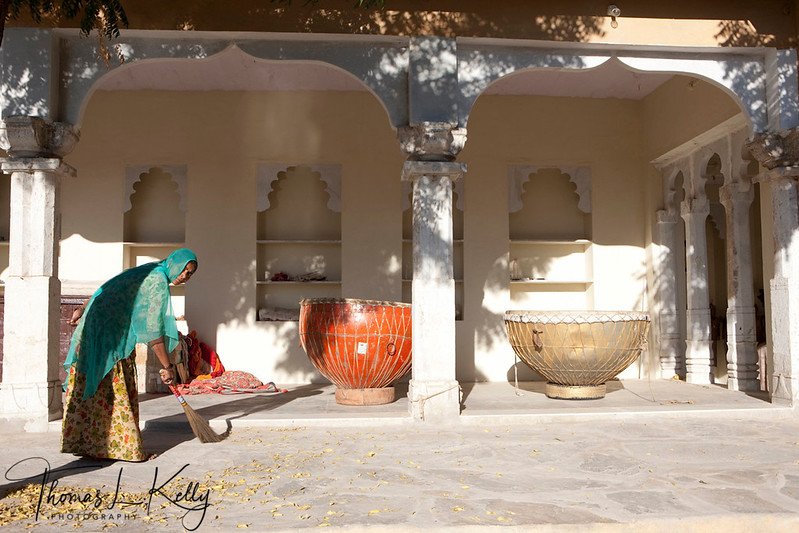 Owner Ajit Singh's mother at their stable's outside porch. Two big traditional Rajasthani drums dot the porch.