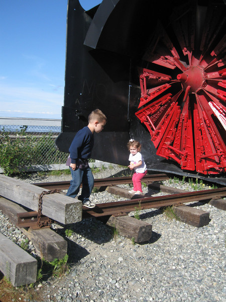 Hugh and Hilary Hanson at the snowplow train exhibit outside Anchorage.