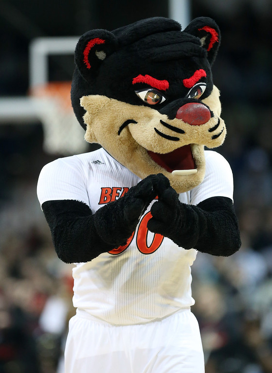 . The Cincinnati Bearcats mascot cheers on his team during their game against the Harvard Crimson in the second round of the 2014 NCAA Men\'s Basketball Tournament at Spokane Veterans Memorial Arena on March 20, 2014 in Spokane, Washington.  (Photo by Stephen Dunn/Getty Images)