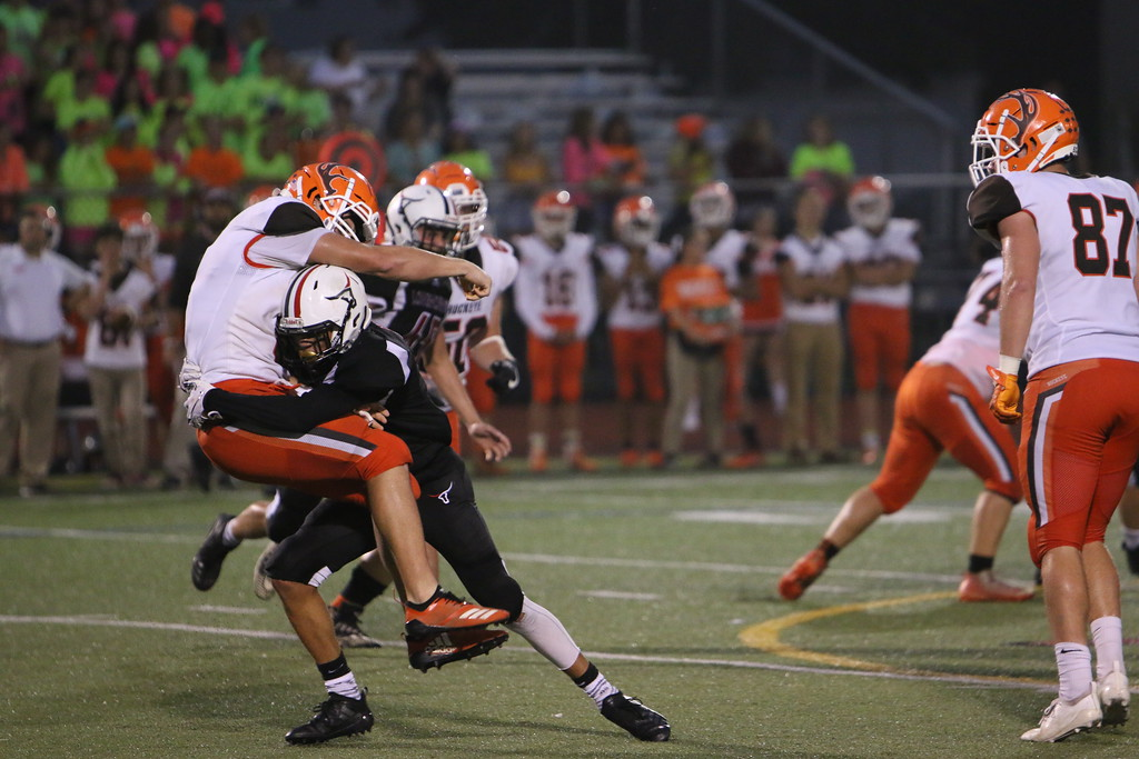 . Kyle Sooy - The Morning Journal<br> Buckeys\' Jacob Doerge gets taken down by the Lutheran West defense on Sept. 14.