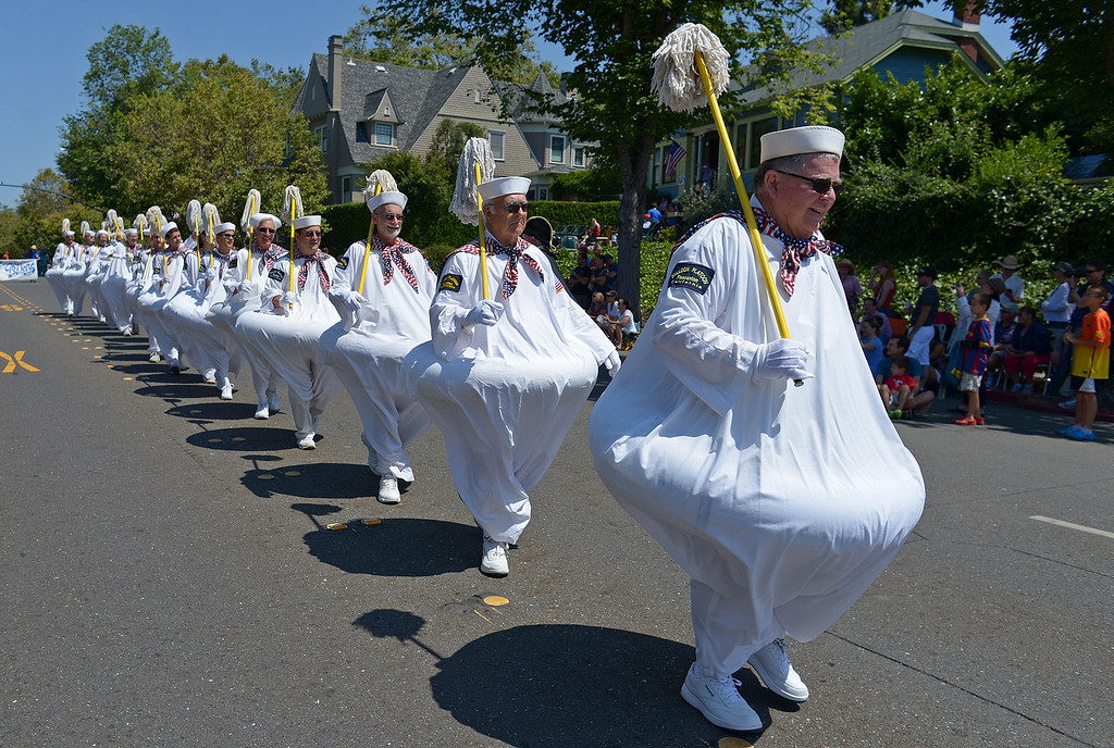 . Balloon Platoon member Jack Ogden, of Pleasanton, leads the march during Piedmont\'s July 4th parade in Piedmont, Calif., on Thursday, July 4, 2013. (Jose Carlos Fajardo/Bay Area News Group)