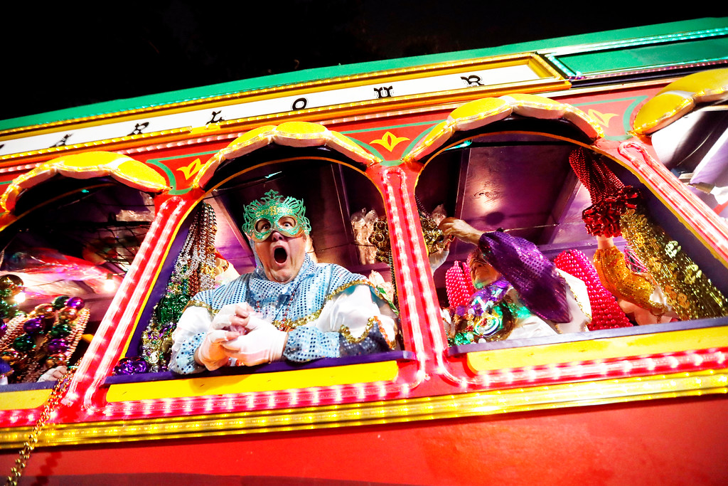 . Float riders encourage the crowd as the Krewe of Orpheus rolls in New Orleans, Monday, Feb. 12, 2018. (AP Photo/Gerald Herbert)