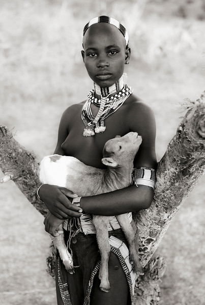 Young woman and her goat from the Hamar tribe.