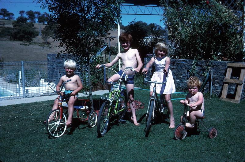 1972-12-6 (19) Andrew 3 yrs 4 mths, David 9yrs Susan 7 yrs 5 mths & Allen 1 yrs 7 mths on bikes by pool.jpg