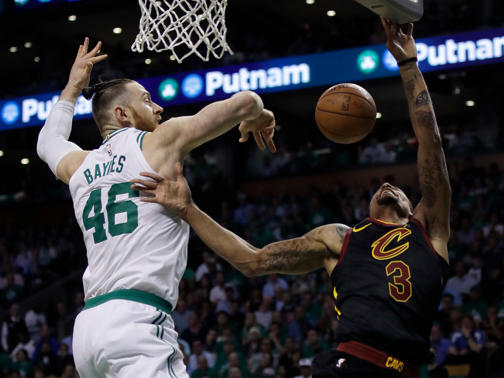 . Boston Celtics center Aron Baynes (46) blocks a shot by Cleveland Cavaliers guard George Hill (3) during the first quarter of Game 5 of the NBA basketball Eastern Conference finals Wednesday, May 23, 2018, in Boston. (AP Photo/Charles Krupa)