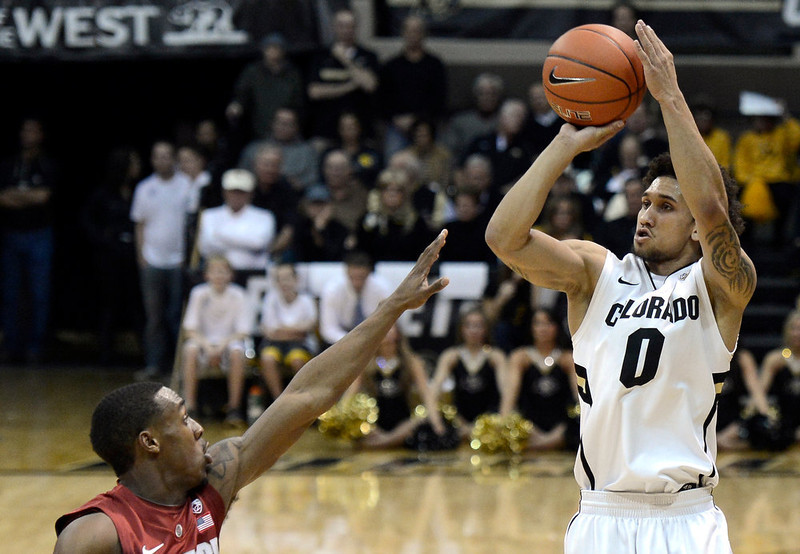 . University of Colorado\'s Askia Booker shoots a three-pointer over Gabriel Harris during a game against Stanford on Thursday, Jan. 24, at the Coors Event Center on the CU campus in Boulder.   Jeremy Papasso/ Camera