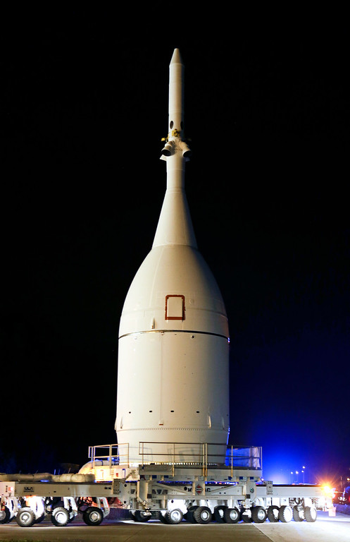 . The Orion spacecraft begins its approximately 22-mile journey at the Kennedy Space Center to Space Launch Complex 37B at the Cape Canaveral Air Force Station in Cape Canaveral, Fla. on Tuesday, Nov. 11, 2014. The unmanned test launch is scheduled for Dec. 4. (AP Photo/John Raoux)
