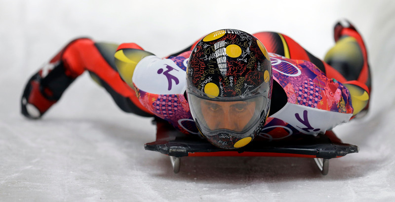 . Ander Mirambell of Spain brakes after his third heat during the men\'s skeleton competition at the 2014 Winter Olympics, Saturday, Feb. 15, 2014, in Krasnaya Polyana, Russia. (AP Photo/Natacha Pisarenko)