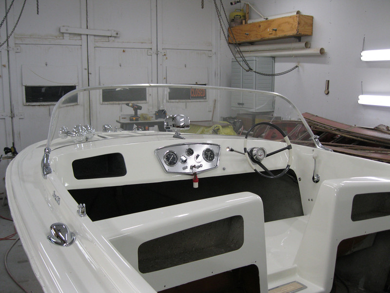 Cockpit area with instruments, windshield and steering installed.