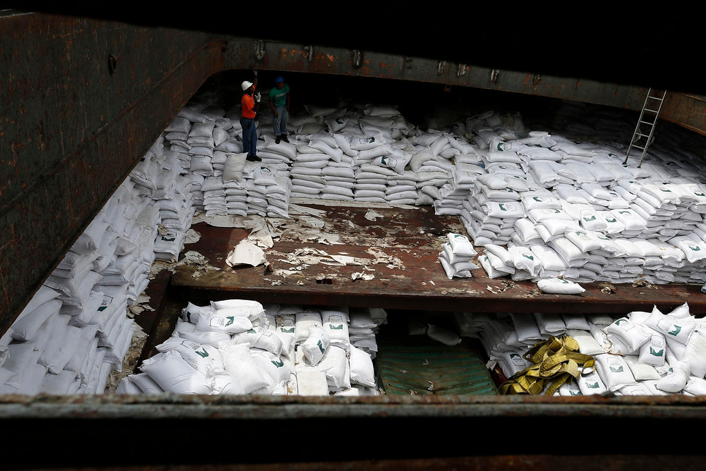 ". Worker stand on top of  bags labeled ""Cuban Raw Sugar\"" inside a North Korean flagged ship \""Chong Chon Gang\"" docked at the Manzanillo Container Terminal in Colon City July 16, 2013.  REUTERS/Carlos Jasso"