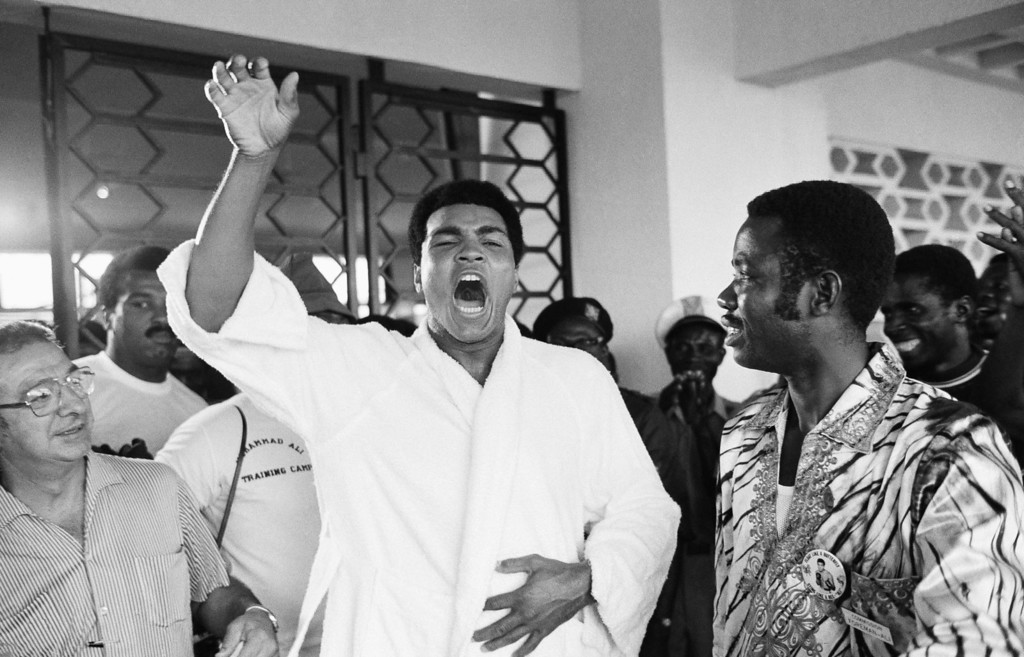 """. Muhammad Ali, due to fight George Foreman, world heavyweight champion, Sept. 24, 1974 in  Kinshasa, Zaire, tells a crowd of boxing fans in N\' Sele, Thursday, Sept. 12, 1974  \""""Ako bo mai ye,\""""  which translates from Zaire\'s Lingalla dialect as: \""""I will kill him.\"""" The fight had to be rescheduled to October 29, 1974 after Foreman needed to recover from an eye injury.    (AP Photo/Horst Faas)"""
