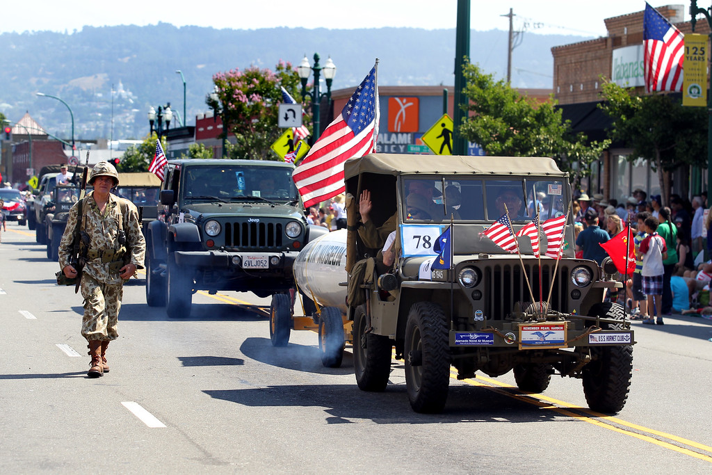 . Vintage military vehicles take part in the Alameda Mayor\'s July 4th Parade on Park Street in Alameda, Calif., on Thursday, July 4, 2013. (Ray Chavez/Bay Area News Group)