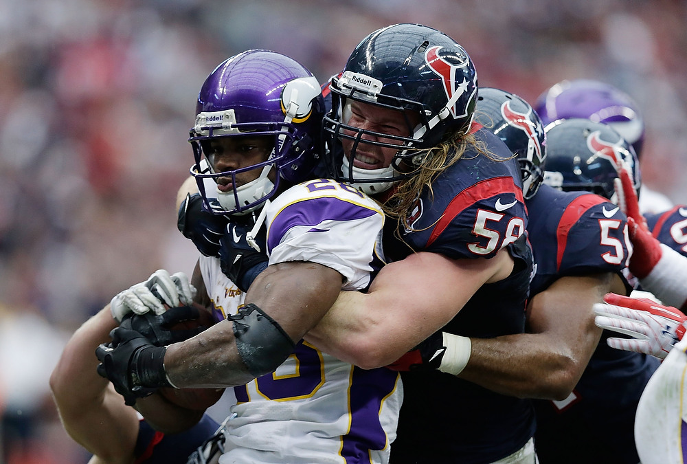. Adrian Peterson #28 of the Minnesota Vikings is stopped by Bradie James #53 and Brooks Reed #58 of the Houston Texans at Reliant Stadium on December 23, 2012 in Houston, Texas.  (Photo by Scott Halleran/Getty Images)