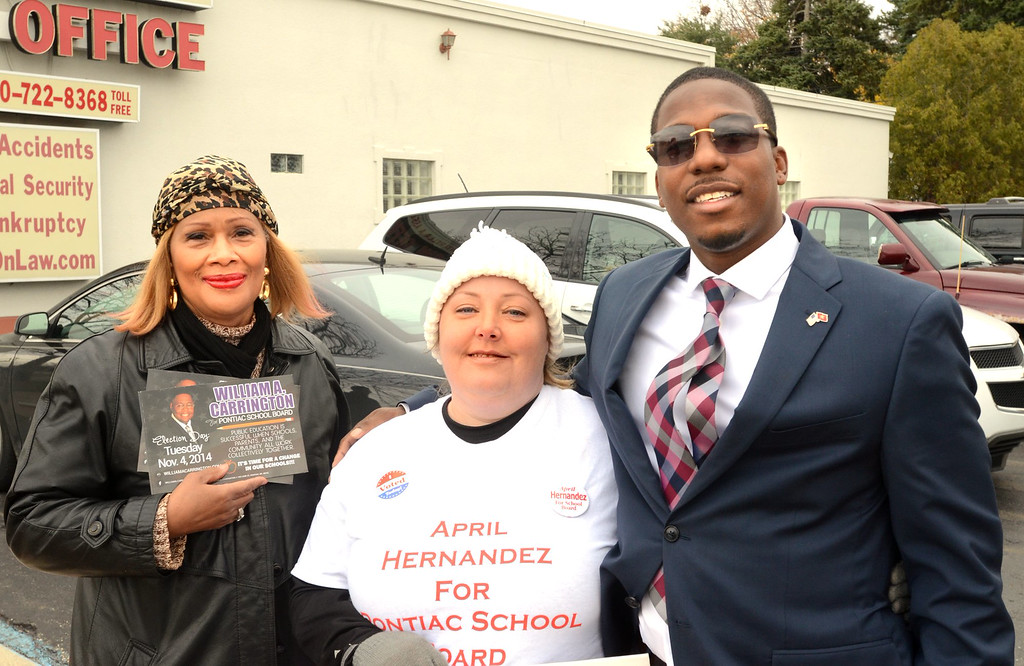 . Community activist Beatroce C;earu, left, and school board candidates April Hernadez and Prince Ravanna-El outside the Ruth Peterson Senior Center in Pontiac    Tuesday, November 4, 2014.  Tim Thompson-The Oakland Press