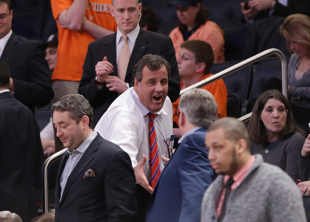 . New Jersey Gov. Chris Christie greets people during the second half in a regional semifinal between Connecticut and Iowa State at the NCAA men\'s college basketball tournament Friday, March 28, 2014, in New York. (AP Photo/Frank Franklin II)